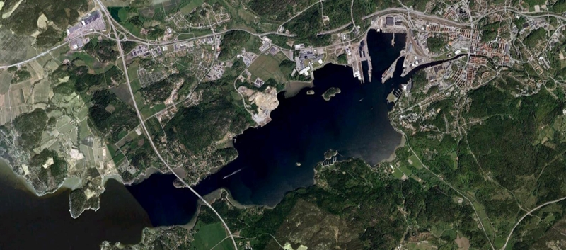 Byfjorden from above. The city of Uddevalla is located in the eastern and innermost part of the fjord. The sill is located in the western part of the fjord and separates the Byfjord from the Havstensfjord. The sill is very shallow and the motorway E6/Sunninge bridge goes across it.